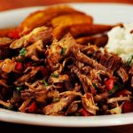 Carne mechada, el corazón de las arepas